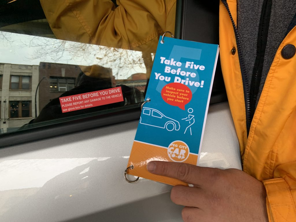 """Fleet manager holding """"Take 5 before you drive"""" pamphlet"""