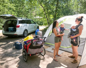 moms chatting at campsite