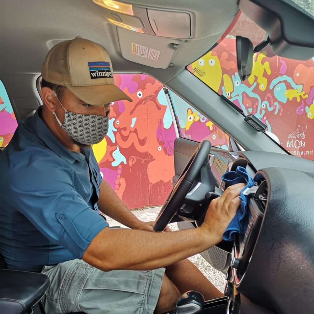 PCCC staff cleaning vehicle interior
