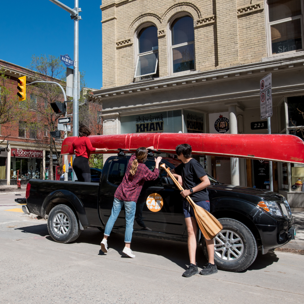 Peg City Car Co-op Truck with Canoe on the roof rack